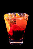 Cocktail Americano on a black background. Cocktail decorated with orange peel and slice,cocktail in a low cocktail glass. Black background Stock Images