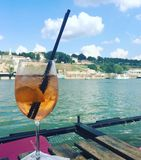 Cocktail Aperol Spritz. Drinking cocktail on a river Stock Photo