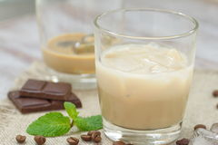 Cocktail with Baileys liqueur, cream and ice. Cocktail with liqueur, cream and ice Royalty Free Stock Images