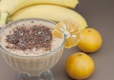 Cocktail of banana and tangerine. Cocktail of banana, tangerine with yogurt and chocolate Stock Image