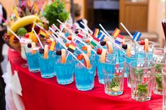Cocktail bar with flags in cocktails. Cocktail bar on wedding reception, flags on cocktails, colorful scene stock photo