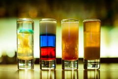 Cocktail bar multicolored cocktails in glass glasses stock images