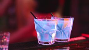 Cocktail at bar in the night club stock footage
