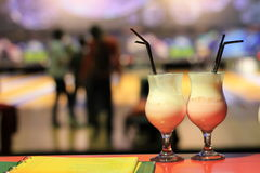 Cocktail. At the bar . Rest of people in a club or restaurant Royalty Free Stock Photo