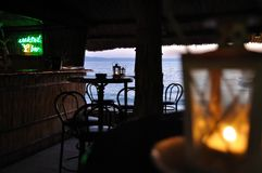 Cocktail Bar With Chairs And Tables And With Sea In Background Royalty Free Stock Photos