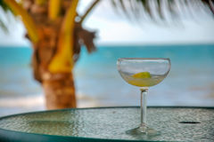 Cocktail on the Beach. A Drink Sitting on a Table in a Tropical Location royalty free stock image