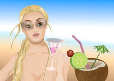 Cocktail on a beach. Young woman drinking Cocktail on a beach Stock Photo