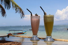 Cocktail on a beach in Bali. Worlds best vacation photo of two cocktails with nice view over the ocean next a beach in Bali Royalty Free Stock Images