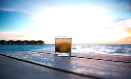 Cocktail in a beach bar. Ice cold cocktail in a beach bar on the maldives at sunset Royalty Free Stock Photos