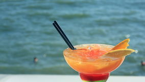 Cocktail on beach, blue sea and sky background.  stock footage