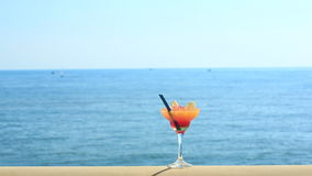 Cocktail on beach, blue sea and sky background.  stock video footage