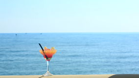 Cocktail on beach, blue sea and sky background.  stock video