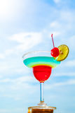 Cocktail on beach, blue sea and sky background Royalty Free Stock Photography