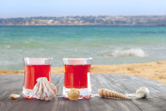 Cocktail on the beach. Seashells on table Royalty Free Stock Images