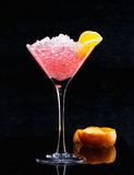 Cocktail on black background. Pink Cocktail on a black background Royalty Free Stock Photography