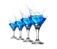 Cocktail blu del curacao con spruzzata fotografia stock