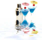 Cocktail with blue curacao & shaker with reflection on water Royalty Free Stock Photography