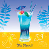 Cocktail Blue Hawaii. At yellow sandy beach on blue marine background with fern leaves, white shells and sign Royalty Free Stock Images