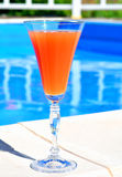 Cocktail on blue pool background Stock Photos