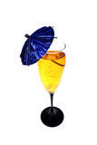 Cocktail with blue umbrella. Cocktail in clear glass with a blue umbrella Stock Images