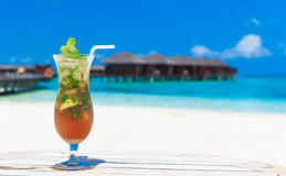 Cocktail with blur beach Royalty Free Stock Image