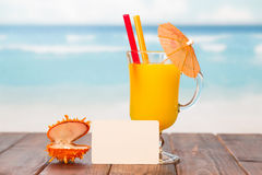 Cocktail with card background Royalty Free Stock Image