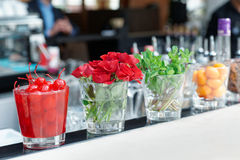 Cocktail cherries, herbs and flowers Stock Photos