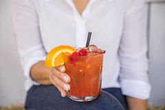 Cocktail with Cherries and a Slice of Orange Stock Photo