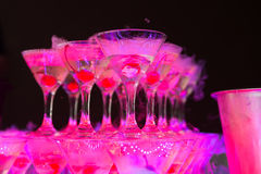 Cocktail with cherry and dry ice on dark background Royalty Free Stock Images