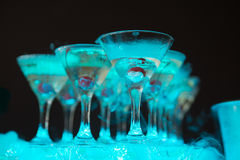 Cocktail with cherry and dry ice on dark background Stock Images
