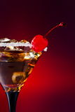 Cocktail with cherry. And ice on red background Royalty Free Stock Image