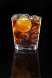 A cocktail of Cola with ice and lime Stock Image