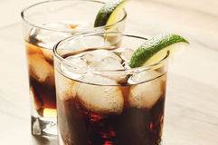 Cocktail with cola and ice Stock Photos