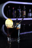 Cocktail with Cola and lemon on a bar Stock Photos