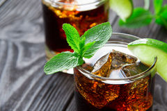 Cocktail with cola, lime and mint Stock Image
