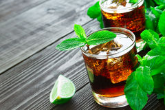 Cocktail with cola, lime and mint Royalty Free Stock Photo