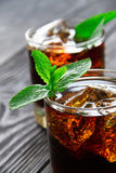 Cocktail with cola and mint Royalty Free Stock Photos