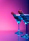 Cocktail Colourful guarniti con le bacche immagine stock libera da diritti