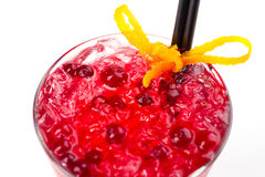 Cocktail with cranberries. Red cocktail with ice and cranberries Royalty Free Stock Photo