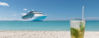 Cocktail and cruise ship on summer vacation. Stock Images