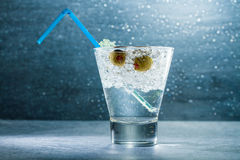 Cocktail with crushed ice and olives Stock Images