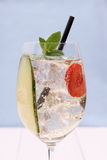 Cocktail with cucumber, strawberry in wine glass Stock Images