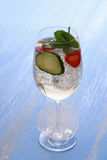 Cocktail with cucumber, strawberry in wine glass Royalty Free Stock Photography