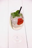 Cocktail with cucumber, strawberry in wine glass Stock Photo