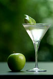 Cocktail daiquiri. White transparent cocktail with blurry green background, beautifully arranged with a piece of lime Stock Image