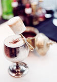 Cocktail decorated with marshmallow in old metal goblet Royalty Free Stock Photography