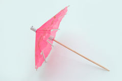 Cocktail decoration. Pink umbrella on white background royalty free stock photo