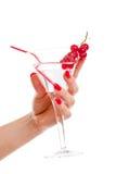 Cocktail della holding della mano della donna Fotografia Stock