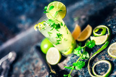 Cocktail details with lime garnish and bar details. Mojito cocktail details with lime garnish and bar details stock photo