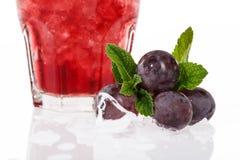 Cocktail di frutta con l'uva Immagine Stock
